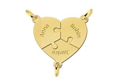 Drie gouden breekhangers in één hart